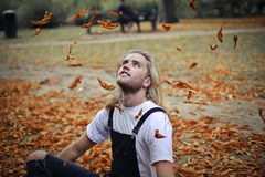 Man between leafs. Man is sitting between leafs Royalty Free Stock Images