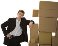 Man lean one's elbows on cardboard boxes Stock Image