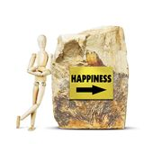 Man leaned against a large rock with an arrow to happiness Stock Images