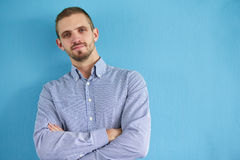 Man leaning against a blue wall Stock Photography