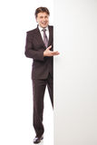 Man leaning against empty board isolated Stock Photography
