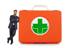 Man leaning against near the first aid box Royalty Free Stock Photography