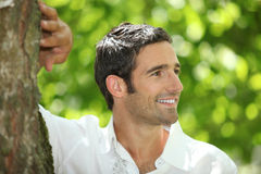 Man leaning against a tree Royalty Free Stock Photography