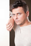 Man leaning against the wall Stock Photography