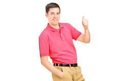 Man leaning against wall and giving a thumb up Royalty Free Stock Photos
