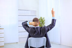 Man leaning back in the chair Stock Image