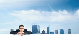 Man leaning on banner Royalty Free Stock Photos