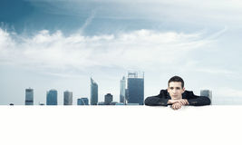 Man leaning on banner Stock Image