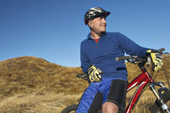 Man Leaning On Bicycle In Field Royalty Free Stock Photography