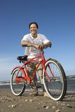 Man leaning on bike. Royalty Free Stock Photo