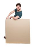 Man leaning on blank poster board Royalty Free Stock Photography