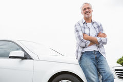 Man leaning on the bonnet Royalty Free Stock Image