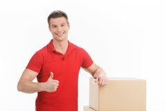 Man leaning on boxes isolated over white background. Royalty Free Stock Photo