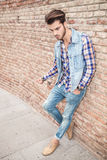Man leaning on brick wall looking down Royalty Free Stock Image