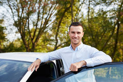 Man leaning on car door stock image