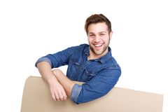 Man leaning on cardboard sign Stock Photo