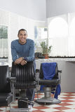 Man Leaning On Chair In Hair Salon Stock Image