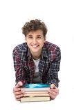 Man leaning on the desk with books. Happy young man leaning on the desk with books Stock Photography