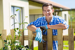 Man leaning fence relaxing Stock Images