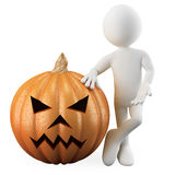 Man leaning on a Halloween pumpkin Stock Image