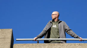 Man leaning on handrail Stock Photo