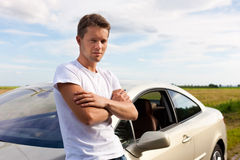 Man leaning on his car Stock Photos