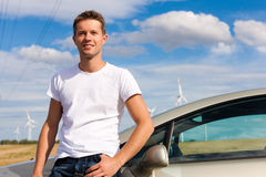 Man leaning on his car Royalty Free Stock Images