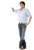 Man leaning on an imaginary object Stock Photography