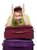 Man leaning on the pile of travel bags Stock Photo