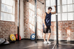 Man leaning on a pole. At the gym Royalty Free Stock Images