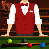 Man leaning on a pool table with cue stick and colorful billiard balls Stock Photography