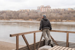 Man leaning on railing and jumping Royalty Free Stock Photography