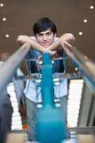 Man leaning on stair railing stock photography