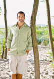 Man leaning on tree at beach Royalty Free Stock Photos