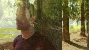 Man leaning on a tree. Digital composite of forest trees and man leaning on a tree stock video footage