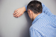 Man leaning on the wall Royalty Free Stock Image