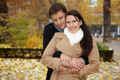 Man leaning on woman in park Stock Photo