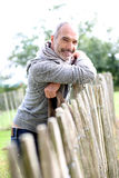 Man leaning on wood fence Royalty Free Stock Images