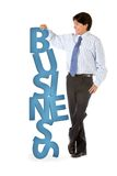 Man leaning on word business Stock Image