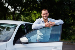 Man leans on car door Stock Photography