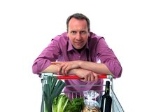 Man leans on shopping cart Stock Photo