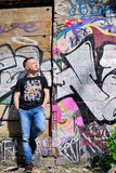 Man leans on wall with graffiti Royalty Free Stock Photos