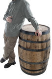 Man leans on whiskey barrel Stock Image