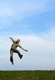 Man leaping playfully stock image