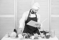 Man learn recipe. Improve cooking skill. Book family recipes. Ultimate cooking guide for beginners. According to recipe. Man bearded chef cooking food. Guy stock image