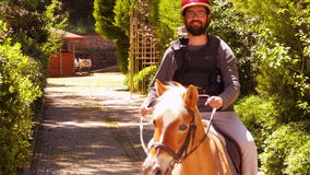 Man learning horse riding, outdoor stock video