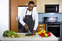 Man Learning How To Cook Royalty Free Stock Photos