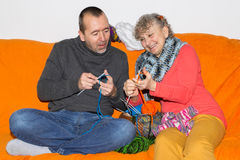 Man learns to knit. Man learns knitting from his mother Royalty Free Stock Photography