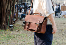 Man with leather bag Royalty Free Stock Image