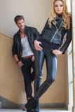 Man in leather clothes is checking a woman out Royalty Free Stock Photo